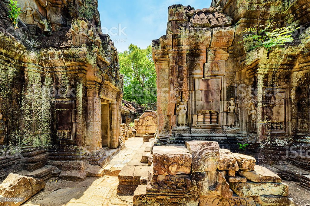Ancient mossy buildings with carving of Ta Som temple stock photo