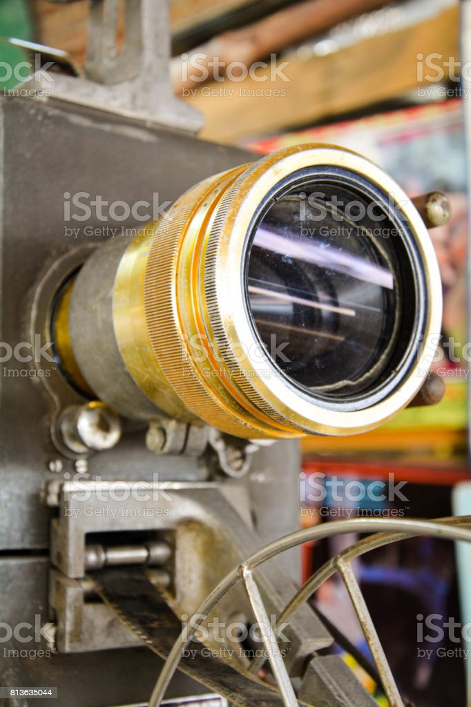 Ancient movie projector lens film old classic stock photo