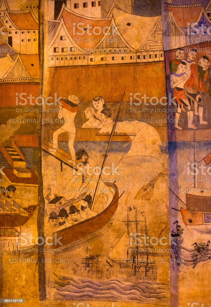 NAN, THAILAND - APRIL 2, 2017 : Ancient mural painting depicting a Thai daily life scene at Wat Phumin in Nan Province, Northern Thailand. stock photo