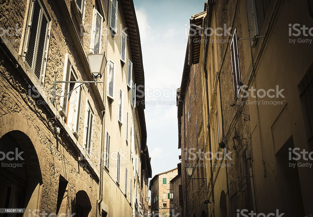 Ancient narrow alley in Tuscan Street. Siena - Italy royalty-free stock photo