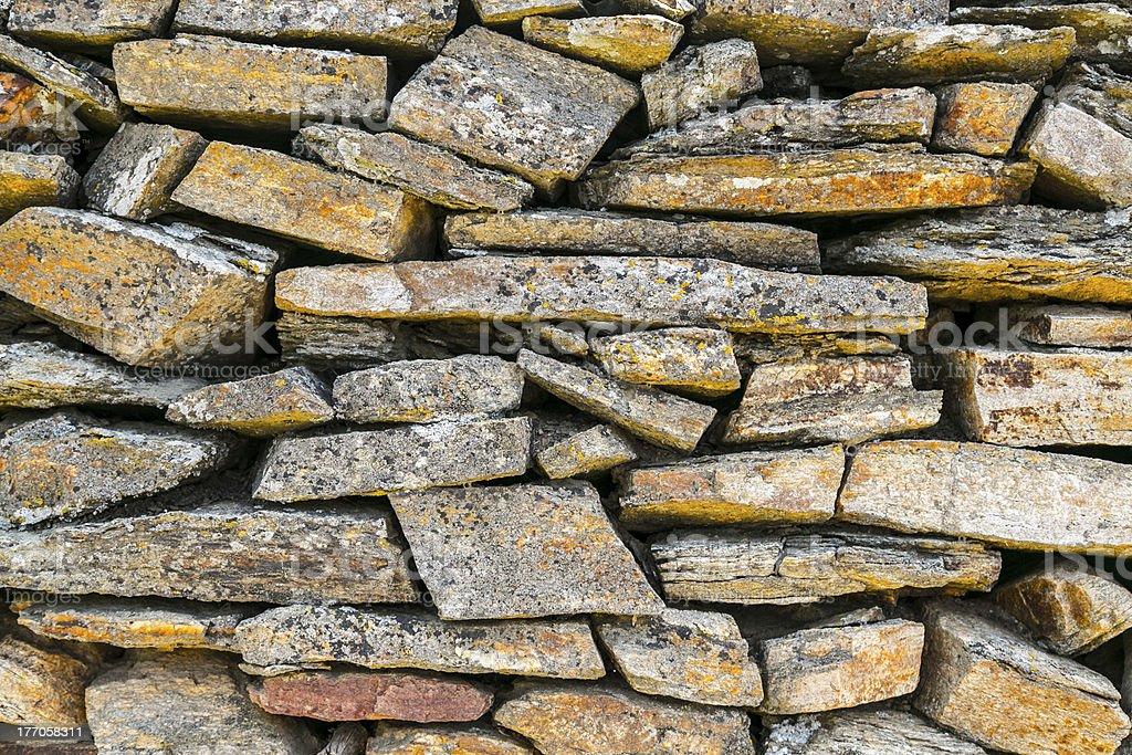 ancient natural stone wall pattern closeup royalty-free stock photo