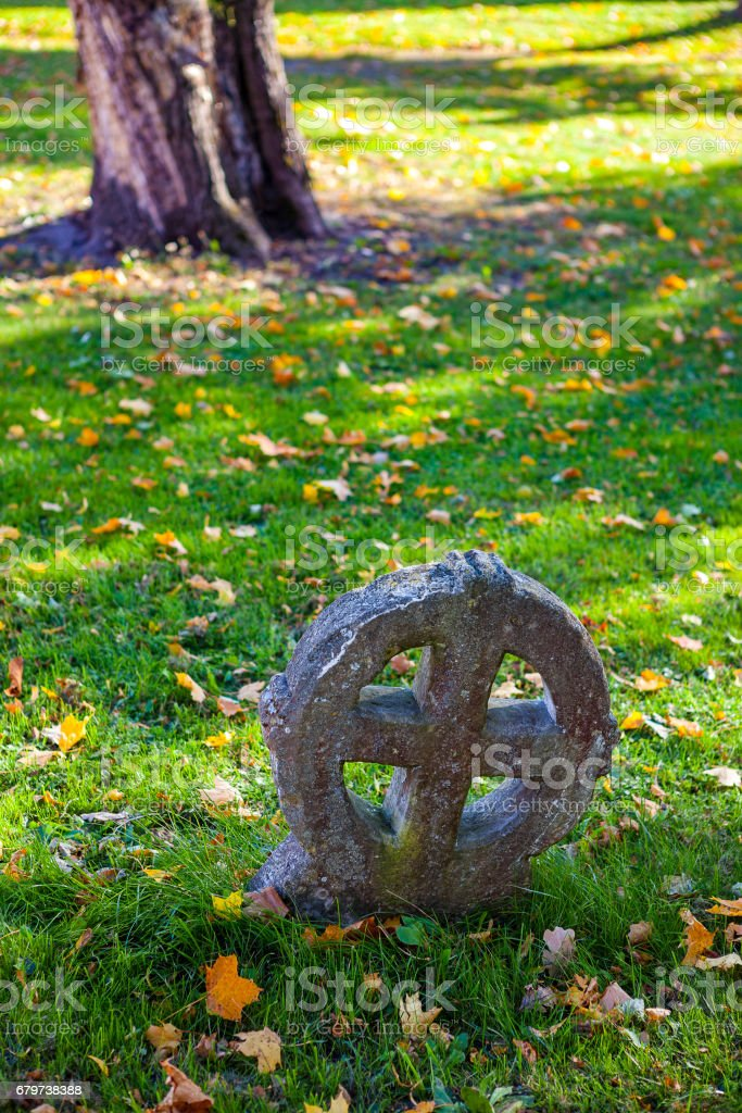 Ancient nordic people's sun cross in a cemetery stock photo