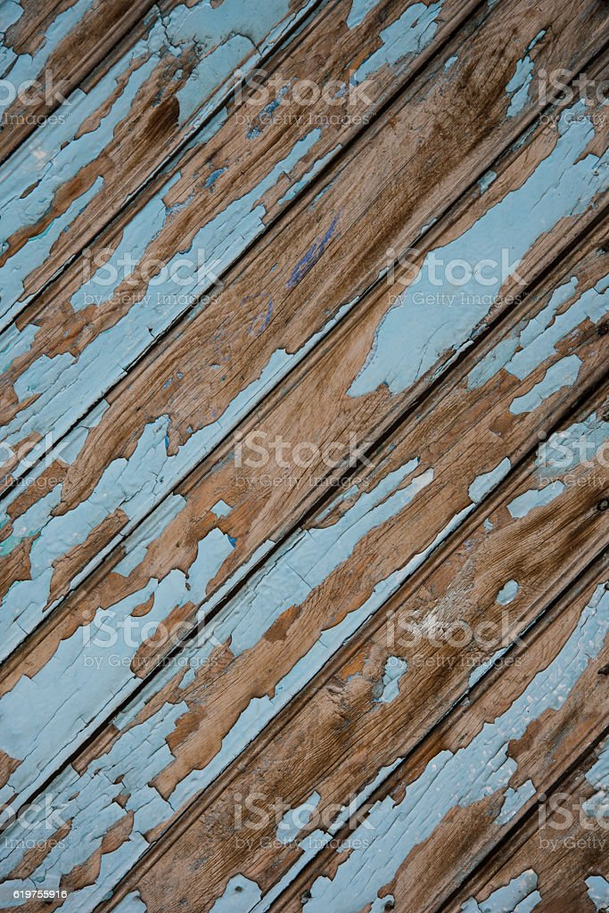 Ancient old wooden door with peeled blue paint stock photo