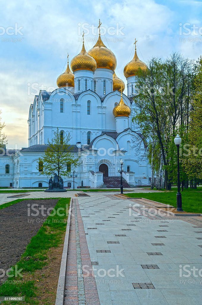 Ancient ortodox curch with golden domes in cloudy evening stock photo