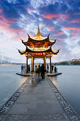 ancient pavilion of Hangzhou west lake at dusk, in China