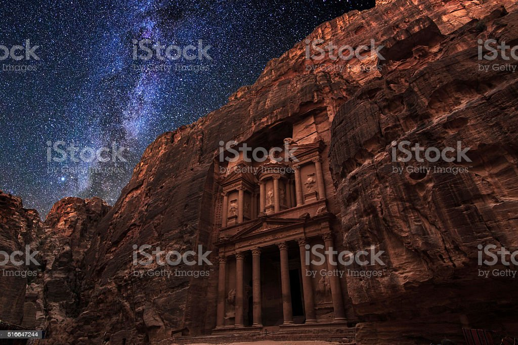 Ancient Petra on the background of the night starry sky stock photo
