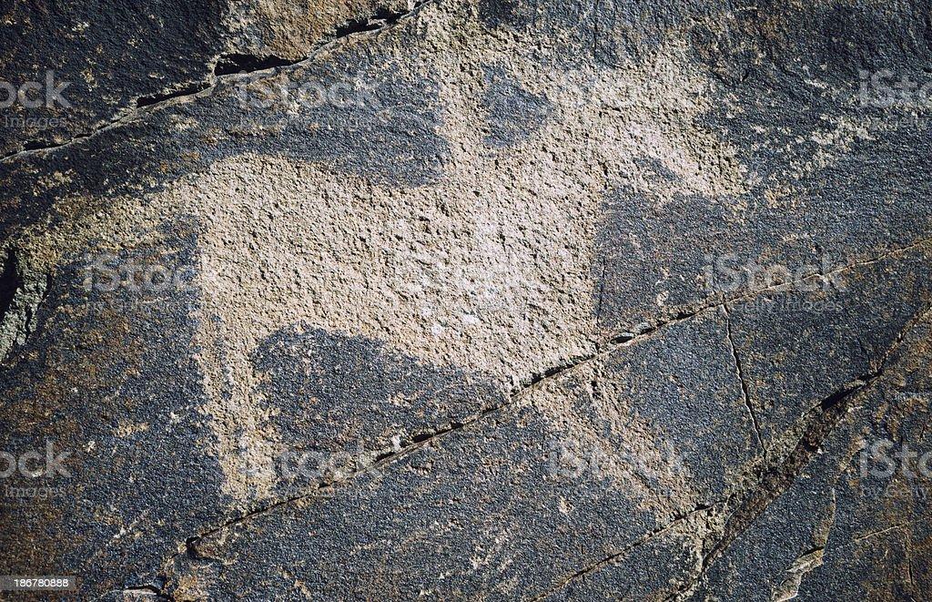 Ancient Petroglyph, Tamgaly, Kazakhstan royalty-free stock photo