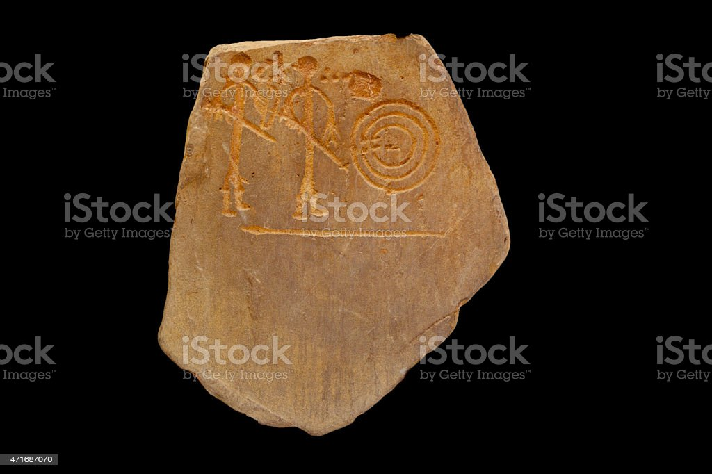 Ancient petroglyph with hunters figures stock photo