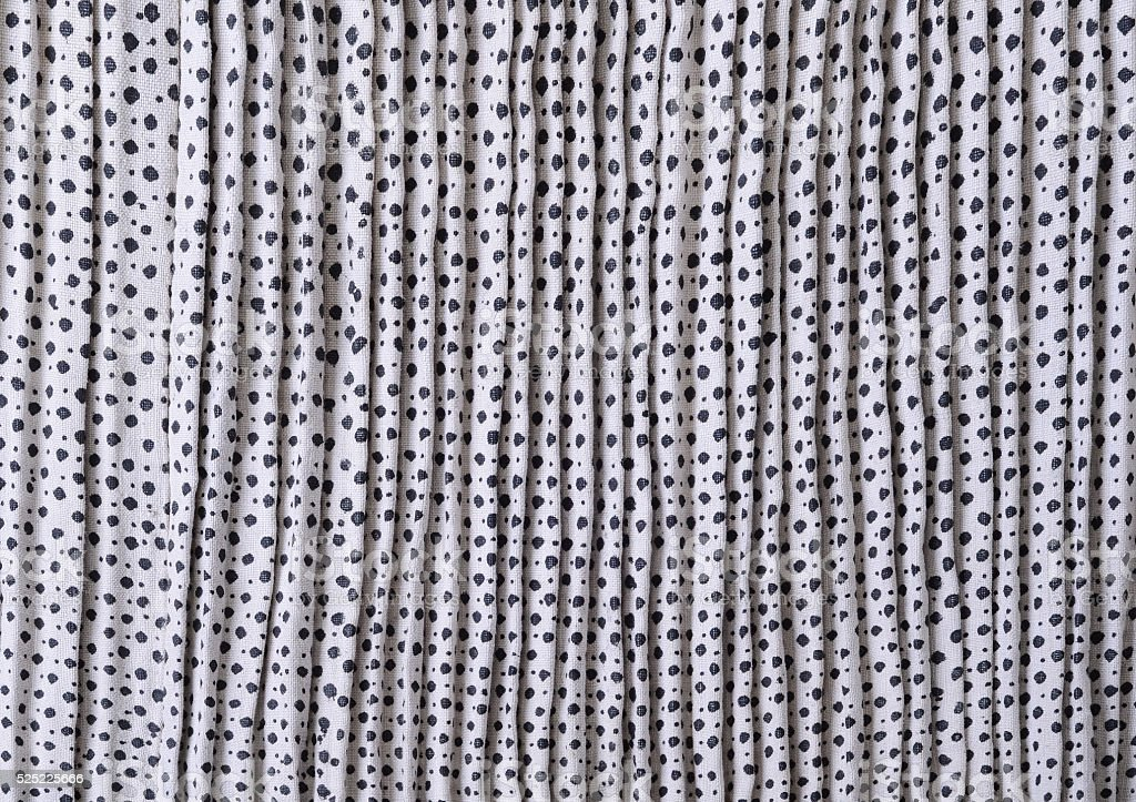 Ancient pleated printed linen cloth stock photo