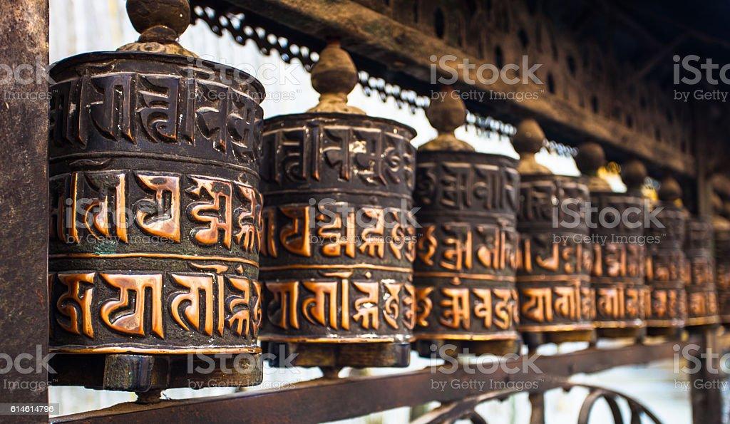 ancient prayer wheels in Buddhist temple stock photo