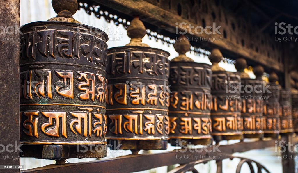 ancient prayer wheels in Buddhist temple stock photo