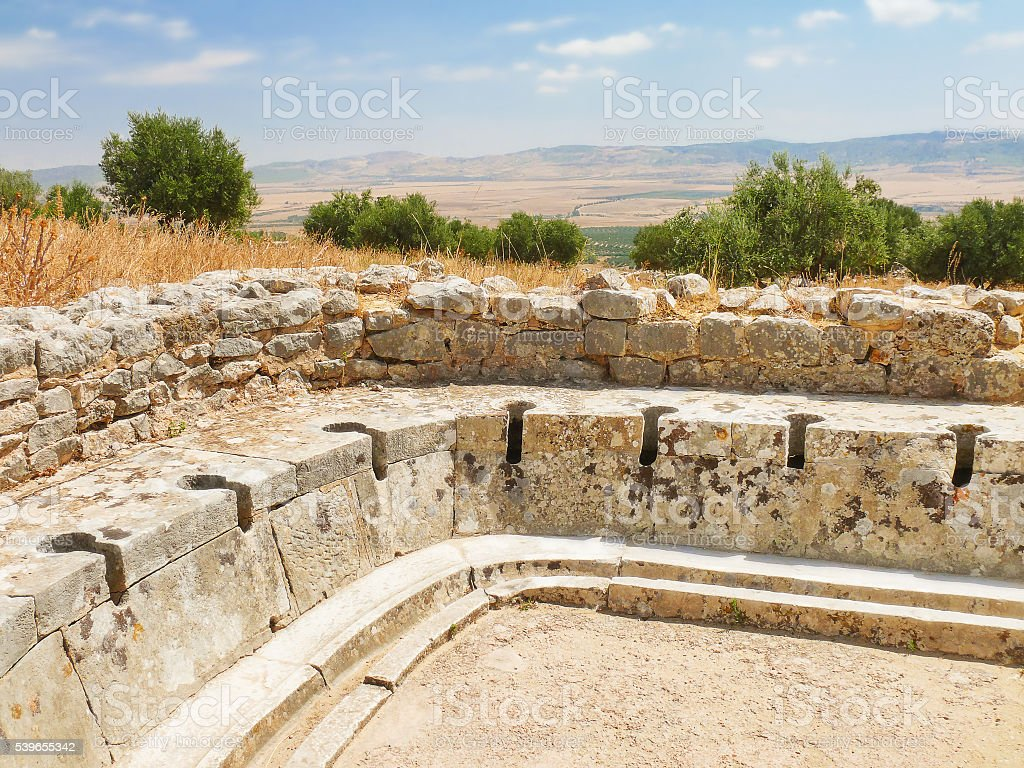 Ancient public toilet. Dougga, Roman Ruins. Tunisia. stock photo