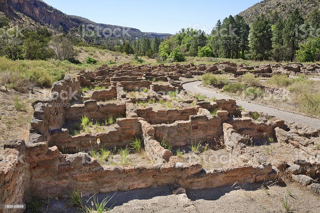 ancient pueblo ruins at Bandelier National Monument in New Mexico stock photo