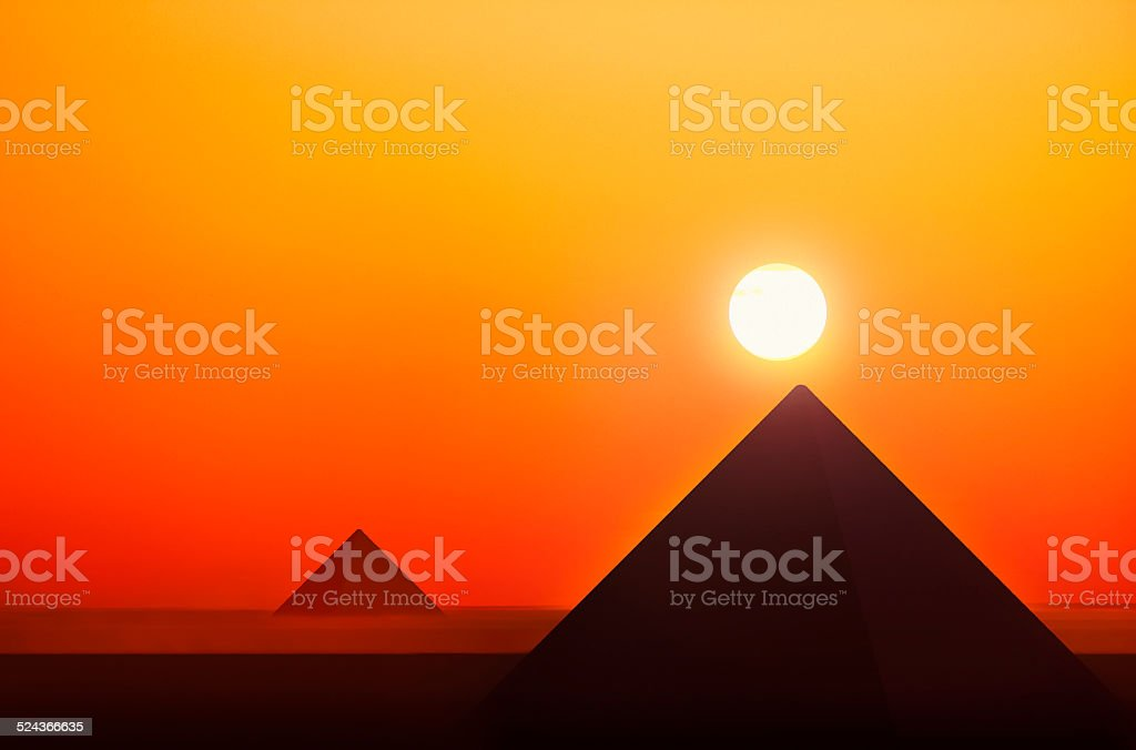Ancient pyramids in sunset stock photo
