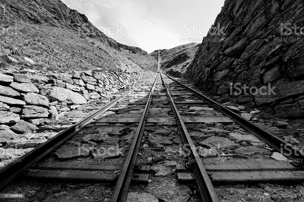 Ancient rail in an abandoned mine royalty-free stock photo