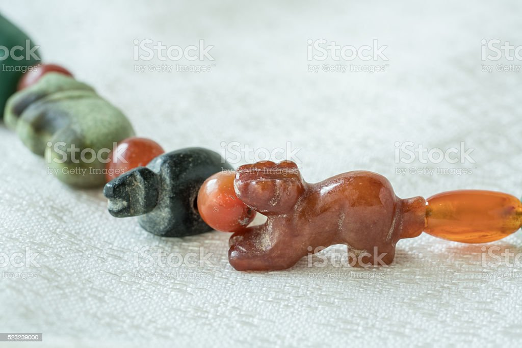 Ancient rare carved tiger stone bead stock photo
