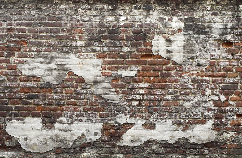 Ancient red brick wall with remaining plaster spots royalty-free stock photo