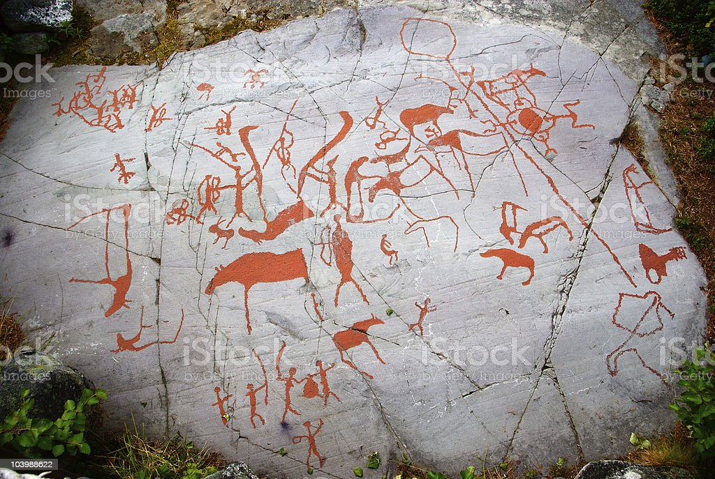 Ancient red carving on a rock in Alta, Norway stock photo