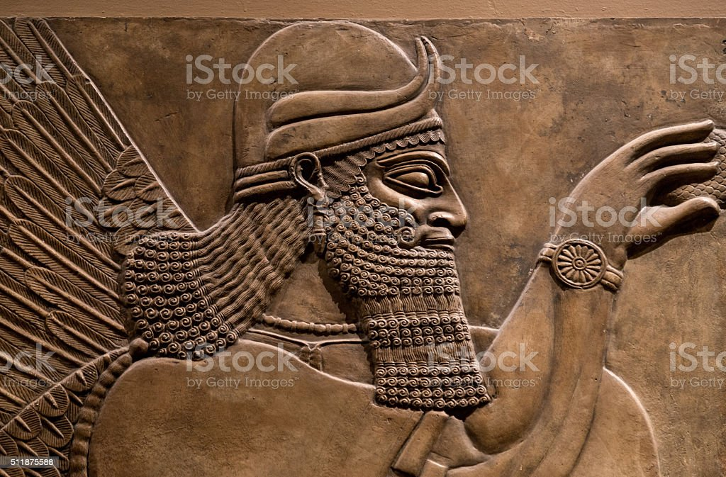 Ancient relief of an assyrian god stock photo