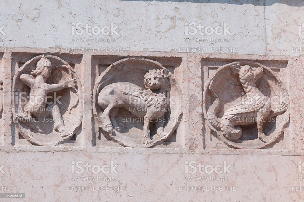 Ancient relief on Baptistry of Parma stock photo