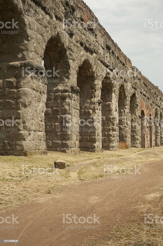 Ancient Roman aqueduct (Parco degli Acquedotti) Roma - Italy royalty-free stock photo