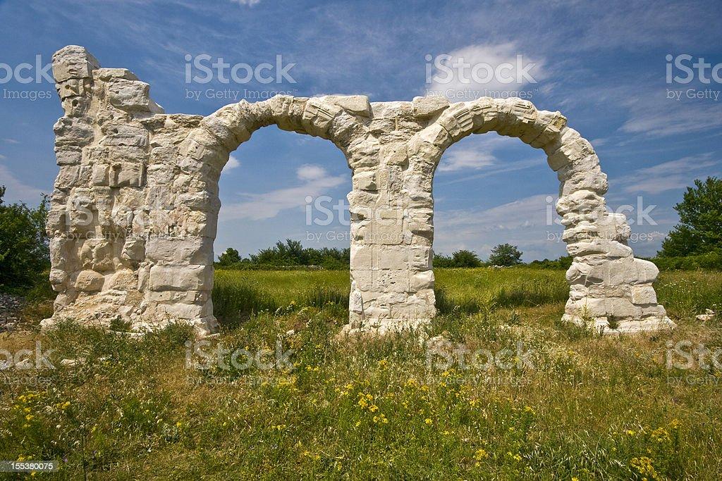 Ancient Roman arches under the sun in Burnum site stock photo
