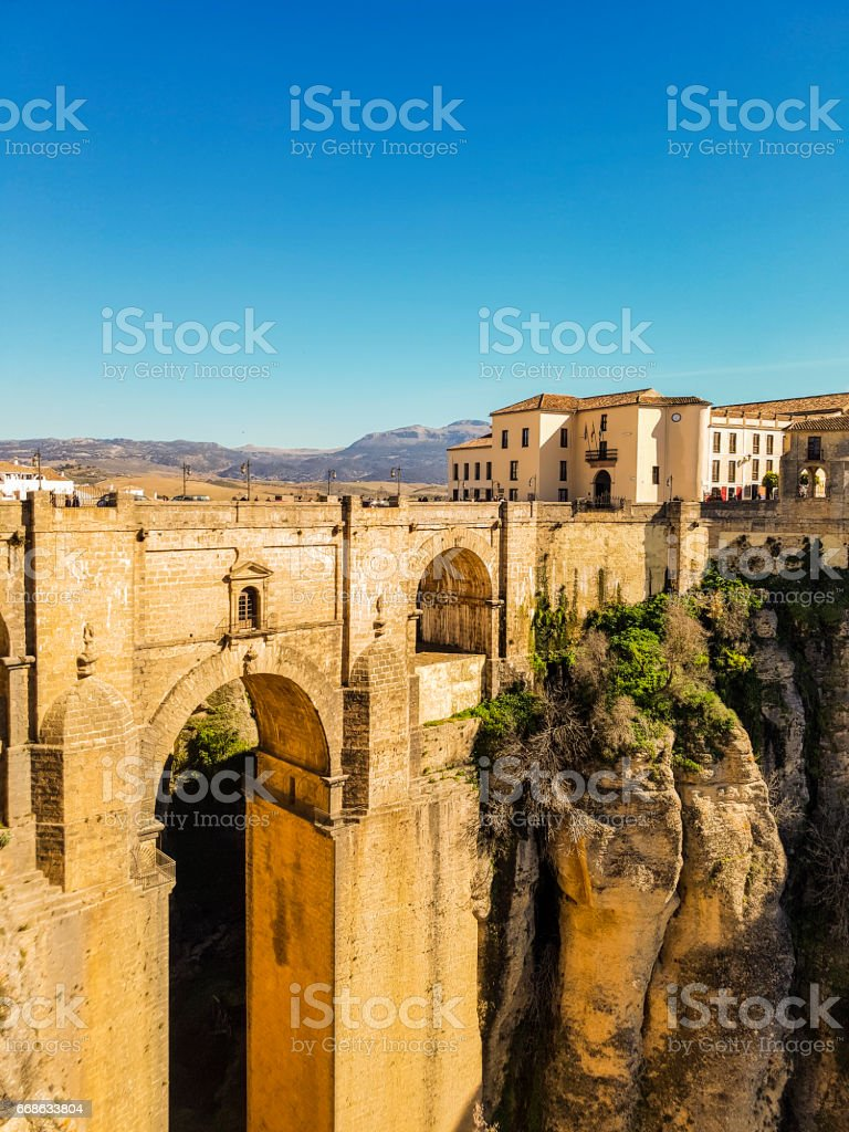 Ancient Roman bridge in Ronda - Puente Nuevo, Spain Andalucia stock photo