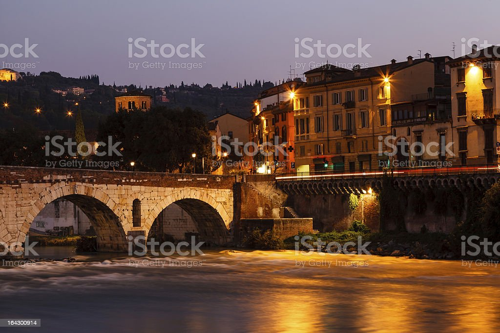 Ancient Roman Bridge over Adige River in Verona at Morning royalty-free stock photo