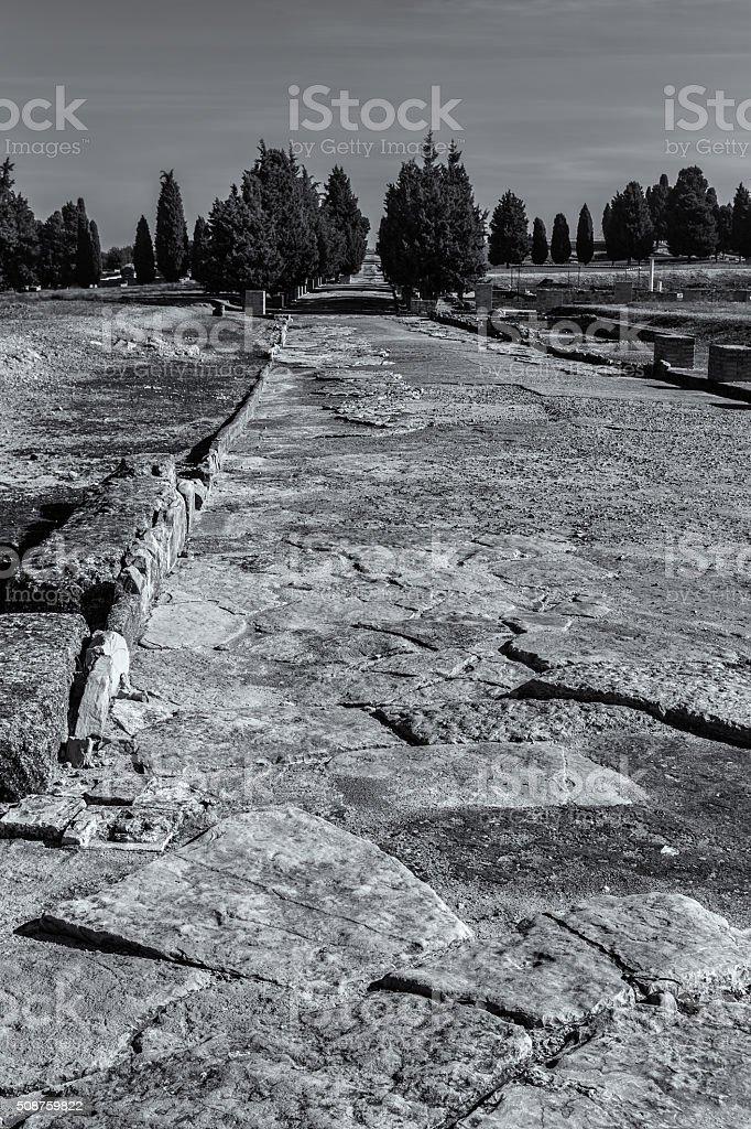 Ancient Roman road in Italica stock photo