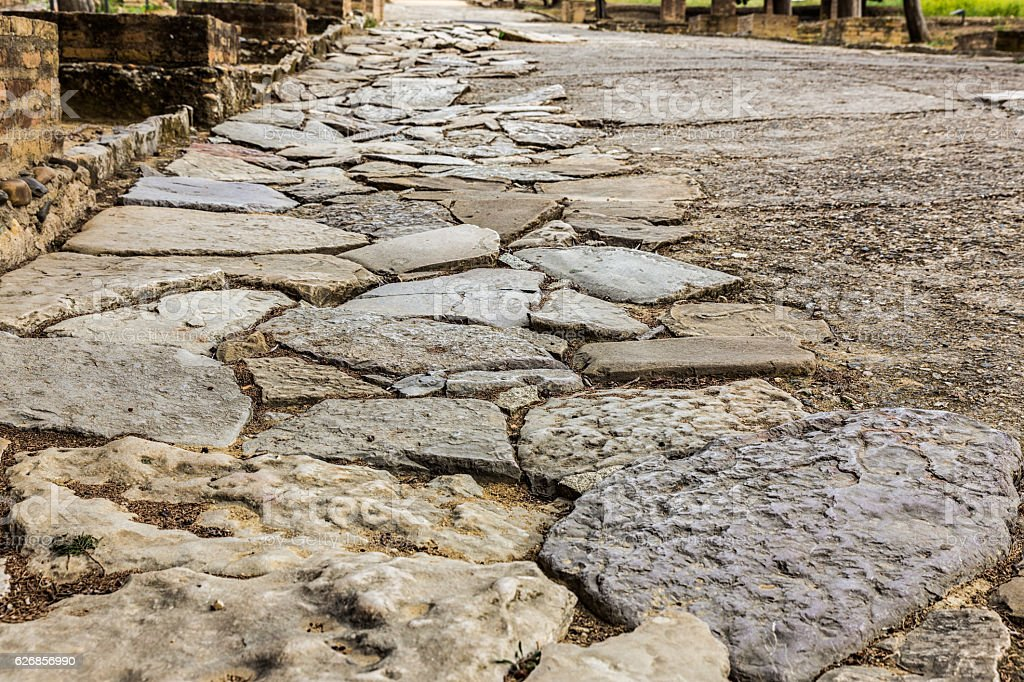 Ancient Roman road in Italica. stock photo