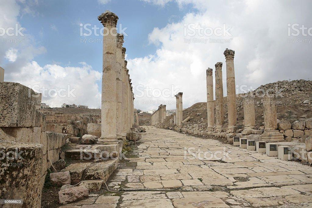 Ancient Roman roadway in Jerash, Jordan royalty-free stock photo