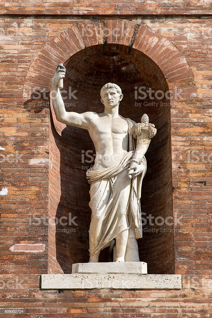 Ancient Roman Statue in Brick Wall Alcove stock photo