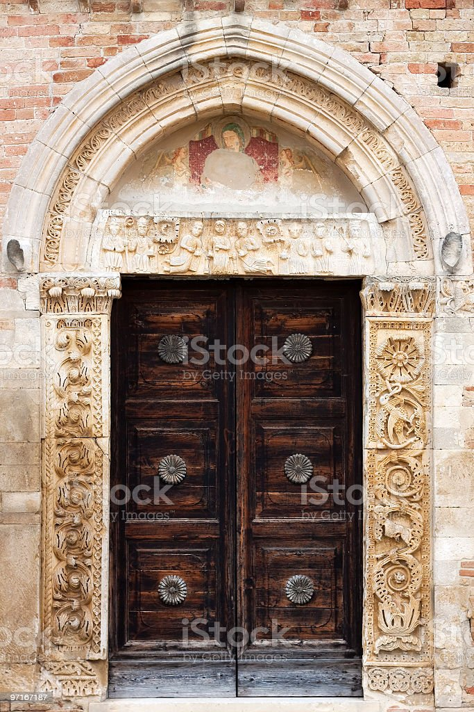 Ancient romanesque church door royalty-free stock photo
