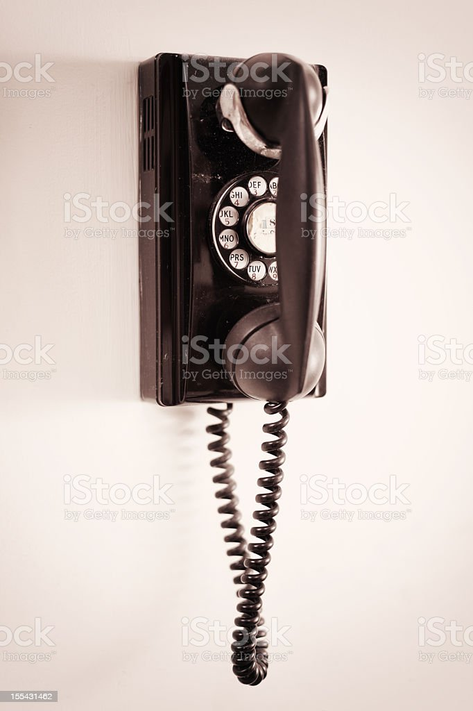Ancient Rotary Dial Wall Telephone stock photo