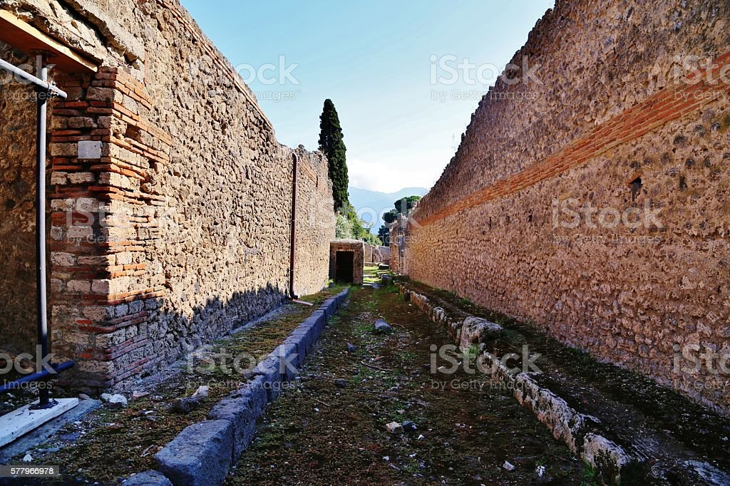 Ancient Rows of Buildings with Sidewalks in between stock photo