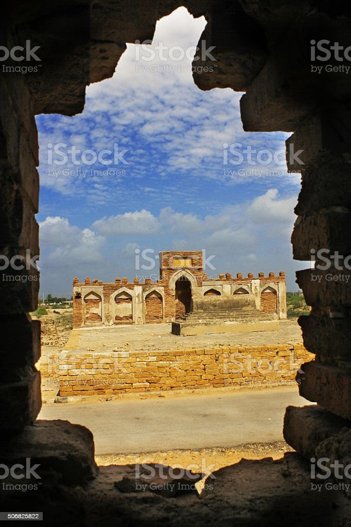 Ancient ruin Tomb through a hole in a wall stock photo