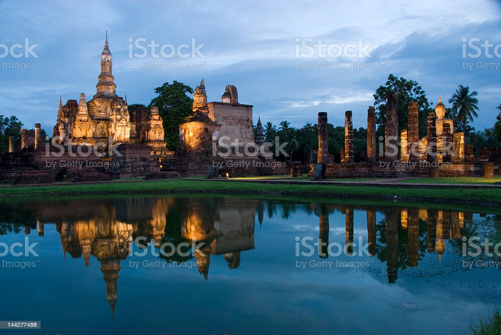 Ancient ruins reflected in a river at dusk stock photo