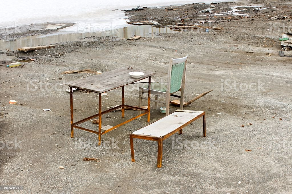 Ancient rural bench from logs. stock photo