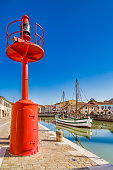 ancient sailboats and lamp on Italian Canal Port