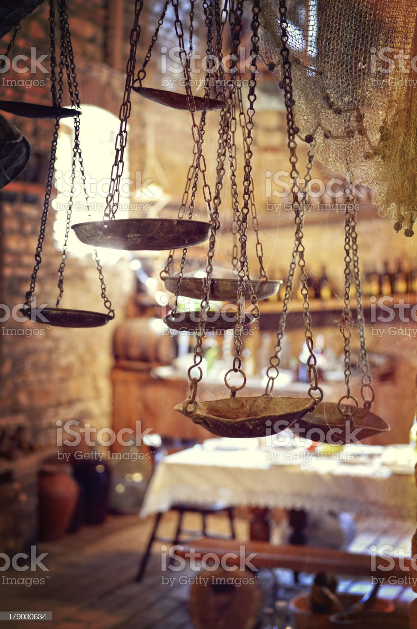 Ancient scales against vintage utensils royalty-free stock photo