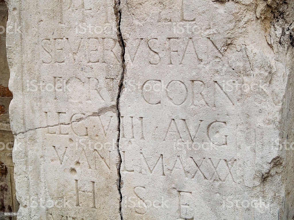 Ancient script on stone royalty-free stock photo