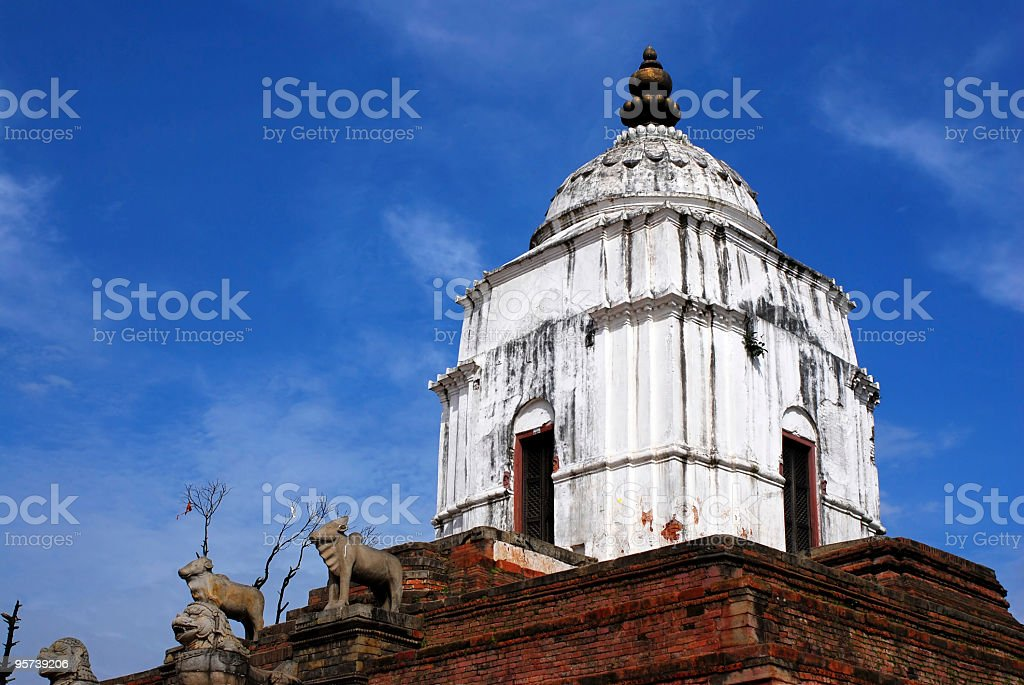 ancient sculpture under blue sky of durbar square,bhaktapur,nepal stock photo