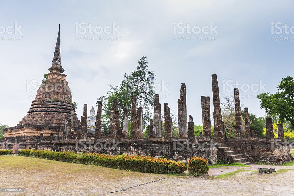 ancient seated buddha staue in the temple ruins royalty-free stock photo