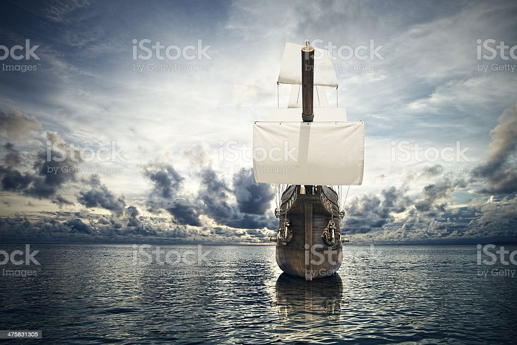ancient ship in the sea stock photo