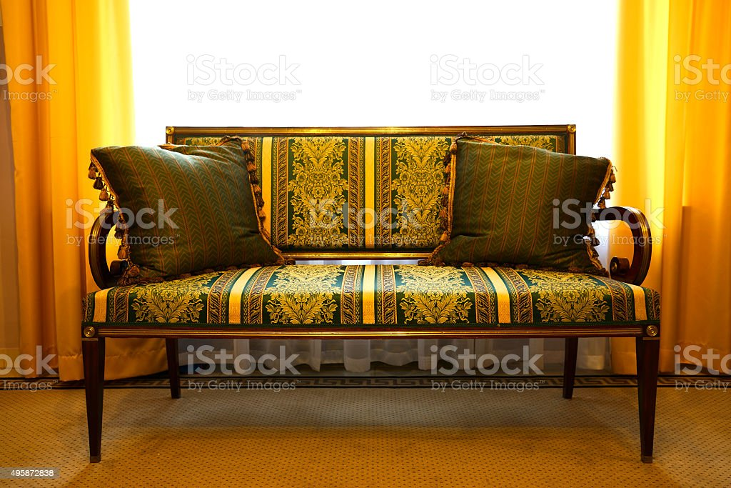 Ancient Sofa with pillows stock photo