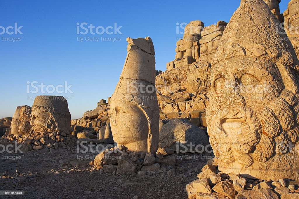 Ancient statue at Mount Nemrut in Turkey at sunrise stock photo