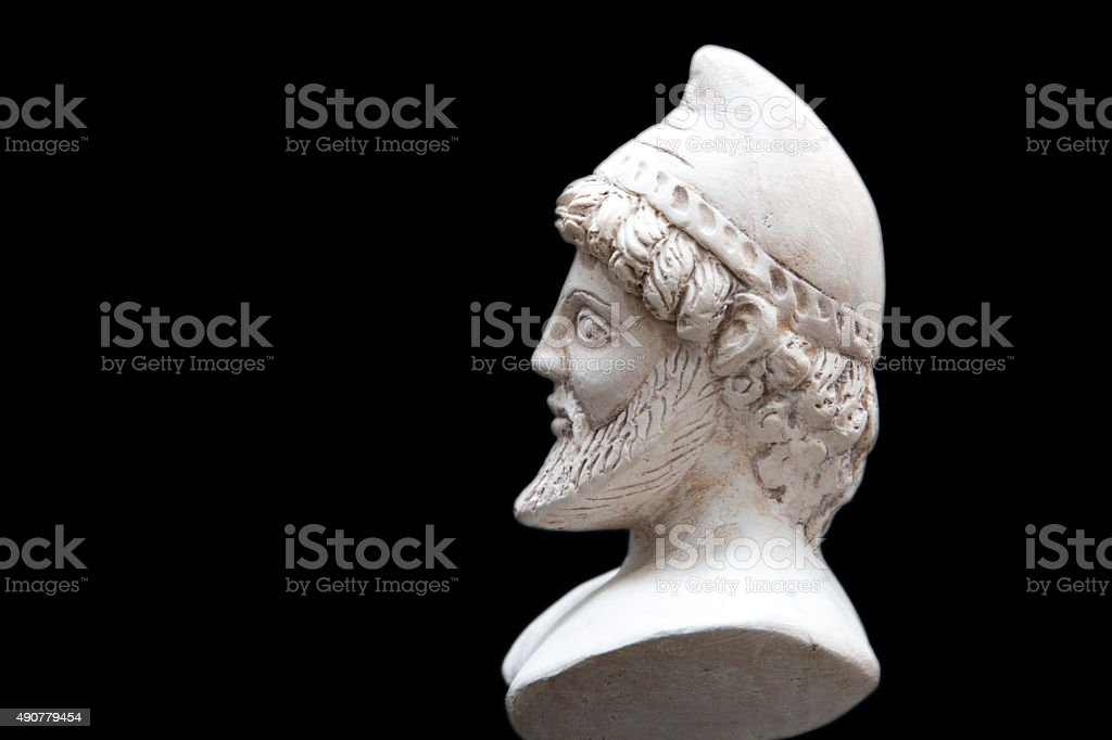 Ancient statue of Odysseus isolated on a black background. stock photo