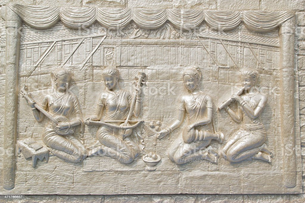 Ancient statue on temple wall,Thailand royalty-free stock photo