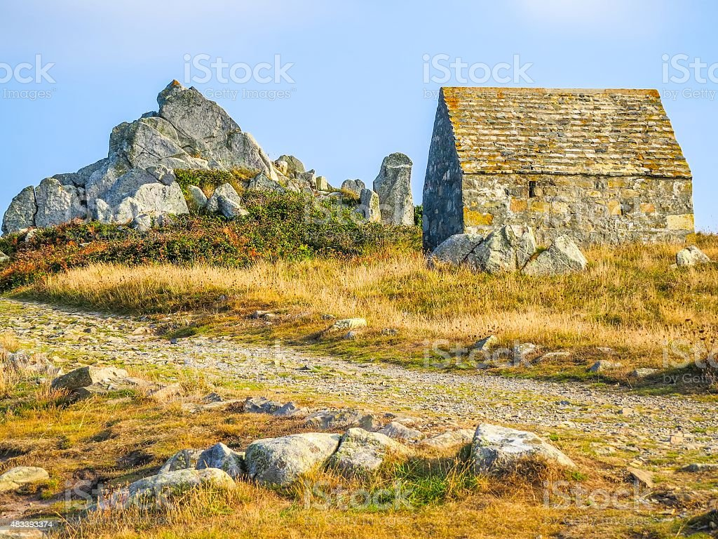 Ancient stone barn on the Guernsey island stock photo
