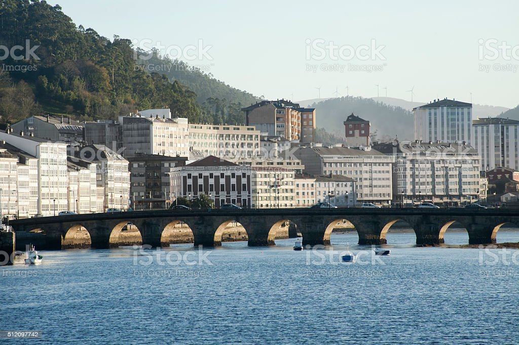 Ancient stone bridge and townscape in Viveiro, Lugo, Galicia, Spain. stock photo